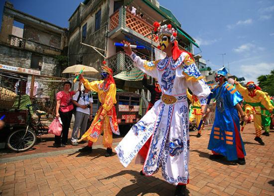 畅享全球缤纷五月节日香港包山节在列(图)
