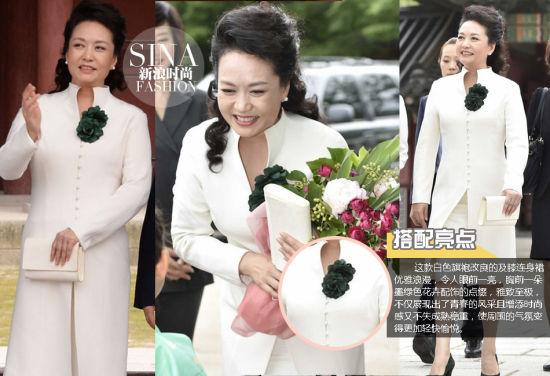 这款白色旗袍改良的及膝连身裙优雅浪漫